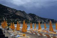 Orange umbrellas in Menton beach, France
