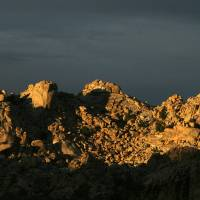 Sunlight on a Desert Rock Range by Eileen Ringwald