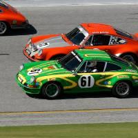 Porsche 911s go head to head Art Prints & Posters by Ron Kertesz