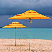 yellow umbrellas and the impending storm