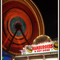 That ferris wheel is fast! Art Prints & Posters by Justin Duray