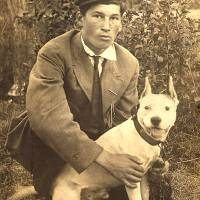"""Vintage image of Boy with White Pitbull"" by BreedHistoryCards"
