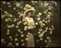 Woman standing in flowering bush