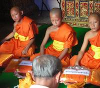 Young Monks Get Presents at Their Ordination