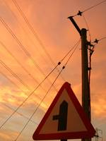 Sunrise With Signpost And Telephone Line