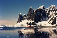 Antarctica Mountains with Red Ship