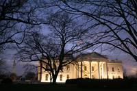 white house with Washington mounument at night