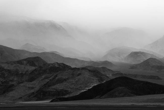 Black and White photo of rain storm over mountains in Death Valley,
