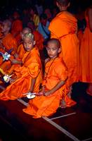 Novice monks wear traditional costume during Poi S