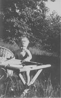 Self as toddler, reading by Priscilla Turner