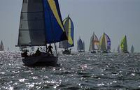 Yachts with unfold spinnaker closeup 1