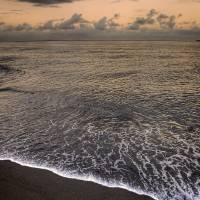 Black Sand of Punalu'u Beach Art Prints & Posters by Jeff Nyveen
