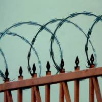Razor wire fence Art Prints & Posters by Candy Torres