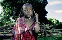 Masai Girl bringin home the firewood