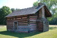 end and back of civil war era cabin