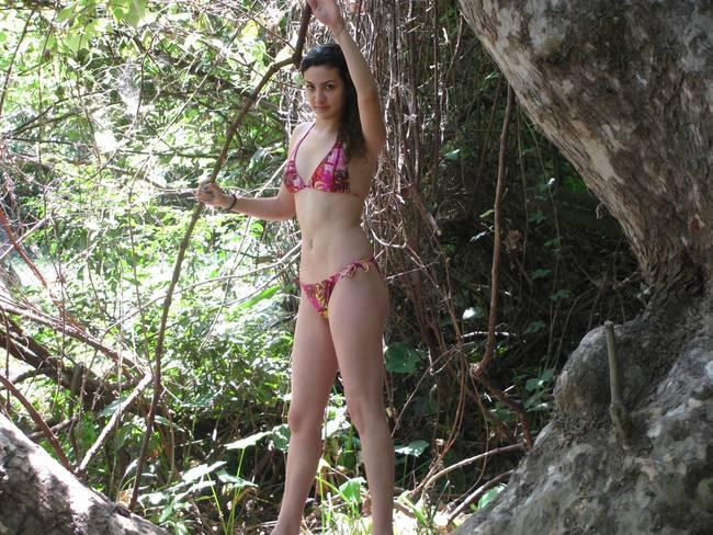 Latina string bikini thumbs