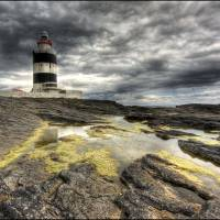 Hook Head lighthouse Co wexford Ireland Art Prints & Posters by Michael Byrne