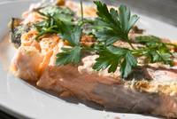 Red Salmon with parsley leafs on the plate