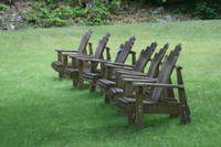 Six Adirondack chairs