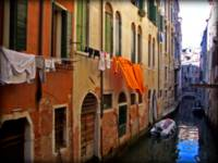 Orange laundry on a Venetian canal