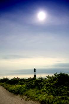 Distant view of the Lighthouse at Fire Island by New Yorkled