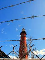 Lighthouse Behind Barbed Wire