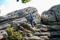 boy climbing on rock