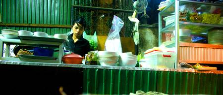 Girl in noodle bar - Siem Reap, Cambodia