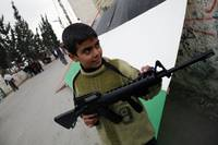 Palestinian Boy Playing with Toy Gun