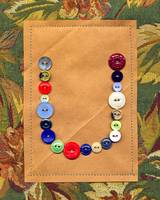 Letter U with Vintage Buttons and Brown Paper Bag