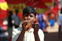 People - Indian man Making Bubbles