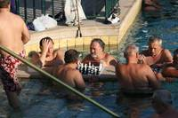 playing chess in the pool