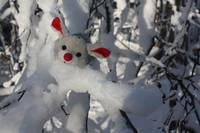 Christmas mouse in a snowy tree