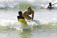 Haiti, local boy surfing with Holly Beck