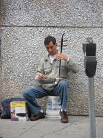 Man playing a Sanxian on Chinatown in San Francisc
