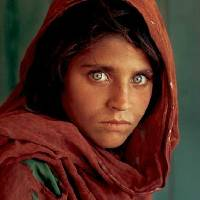 Afgan woman with green eyes Art Prints & Posters by Rose Bayer