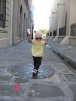 child skipping down alley