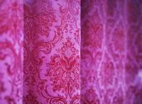 velvet curtain hanging in a window