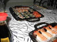 Rolls and Nigiri plus some salmon sashimi.