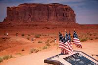 US flags at monument valley