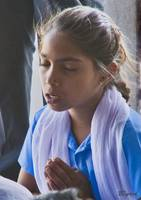 Hindu schoolgirl at morning prayers