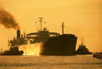 Ship with two Tug Boats by Joe Gemignani