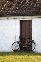 bicycle and door of cottage