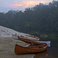 Canoes at sunrise Art Prints & Posters by Michael Trower-Carlucci