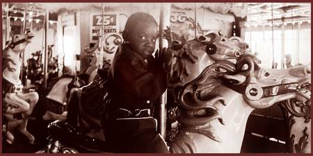 Child on Merry Go Round, Playland at the Beach