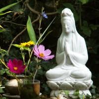 Kwan Yin With Flowers by Through The Split Window