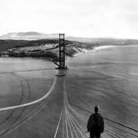 """Man on Golden Gate Bridge, San Francisco"" by worldwidearchive"
