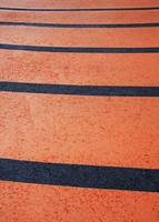 orange pavement with black lines