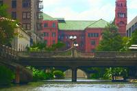 Riverwalk Bridge with Red Buildings 1