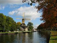Windmill and canal in autumn.